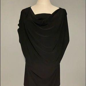 Woman's gently worn black sleeveless tunic